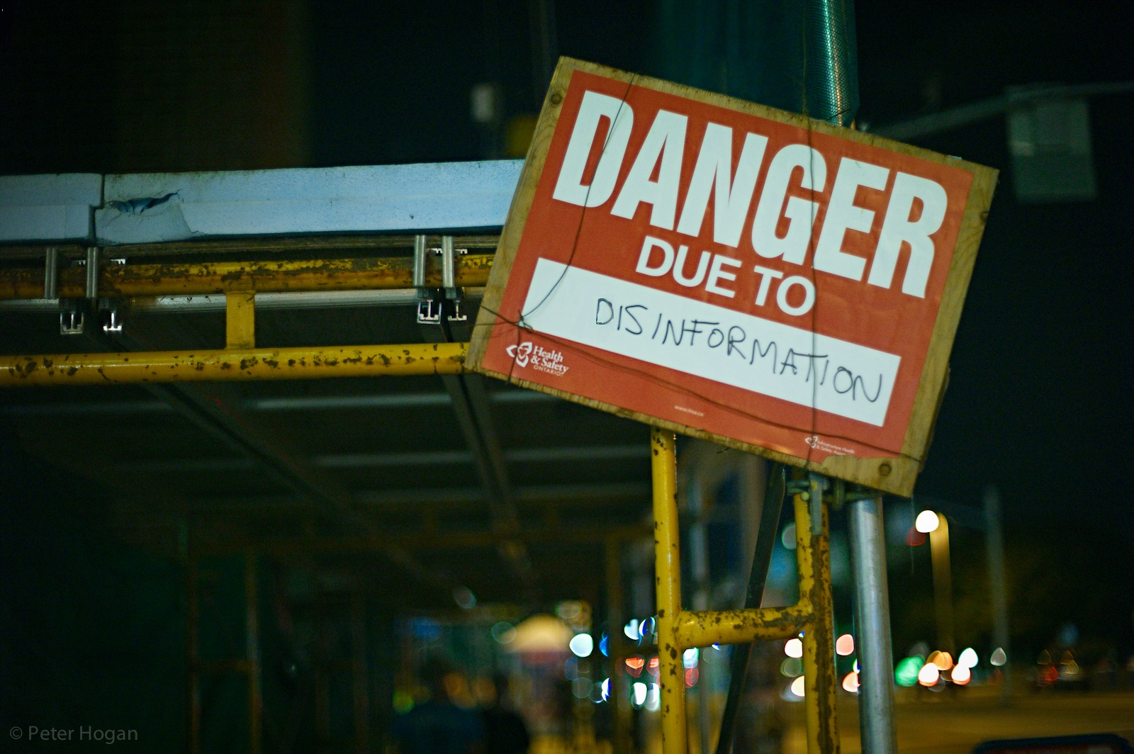 "Sign which states ""Danger due to disinformation"""